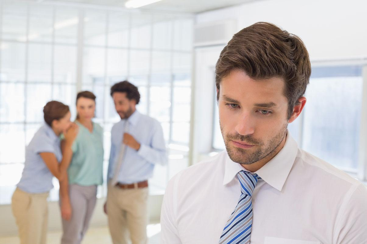 Group of co-workers gosspiing about another co-worker